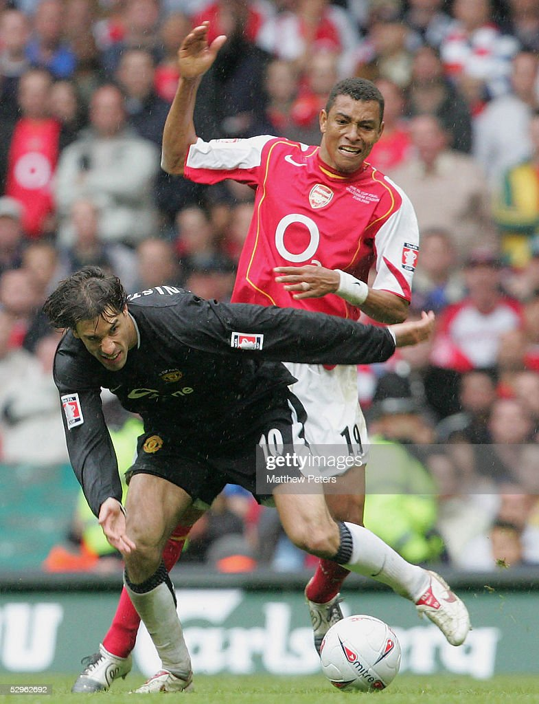 Ruud van Nistelrooy of Manchester United clashes with Gilberto Silva of Arsenal during the FA Cup Final match between Arsenal and Manchester United at the Millennium Stadium on May 21 2005 in Cardiff, Wales.
