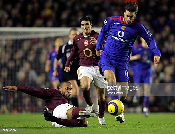 Ruud van Nistelrooy of Manchester United clashes with Thierry Henry of Arsenal during the Barclays Premiership match between Arsenal and Manchester...