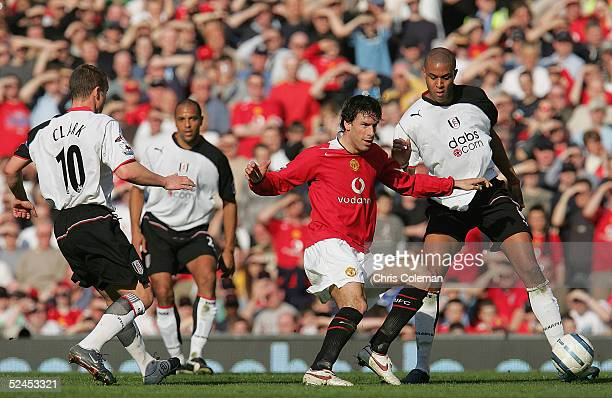Ruud van Nistelrooy of Manchester United clashes with Zak Knight and Lee Clark of Fulham during the Barclays Premiership match between Manchester...