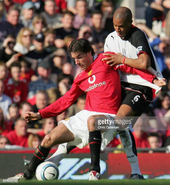 Ruud van Nistelrooy of Manchester United clashes with Zak Knight of Fulham during the Barclays Premiership match between Manchester United and Fulham...
