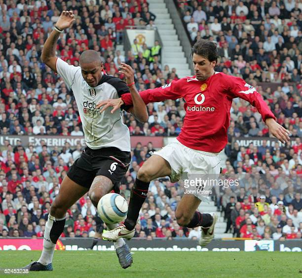 Ruud van Nistelrooy of Manchester United clashes with Zak Knight during the Barclays Premiership match between Manchester United and Fulham at Old...