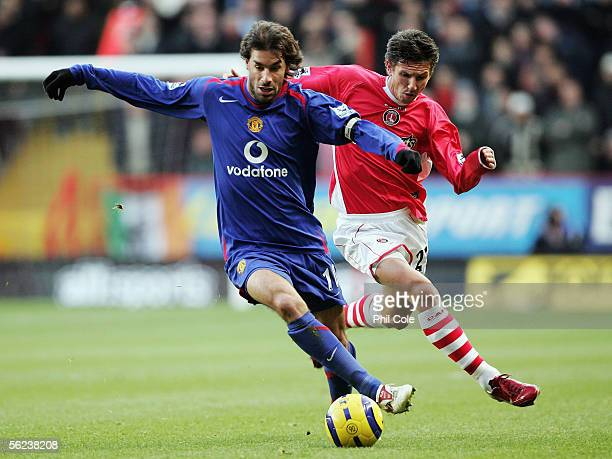 Ruud Van Nistelrooy of Manchester United holds off Alexei Smertin of Charlton Athletic during the Barclays Premiership match between Charlton...