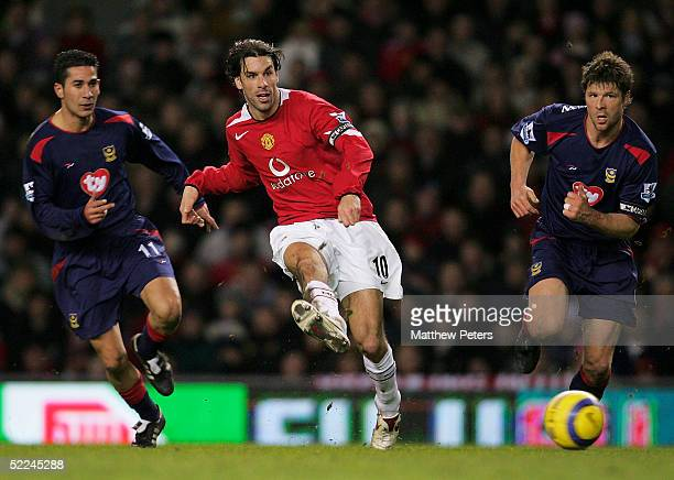 Ruud van Nistelrooy of Manchester United passes the ball as Arjan De Zeeuw and Giannis Skopeletis of Portsmouth give chase during the Barclays...