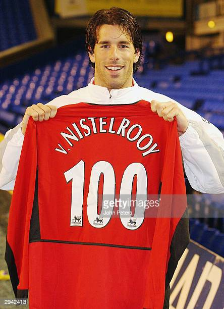 Ruud van Nistelrooy of Manchester United poses with a special shirt to commemorate his 100th goal for the club after the final whistle of the FA...
