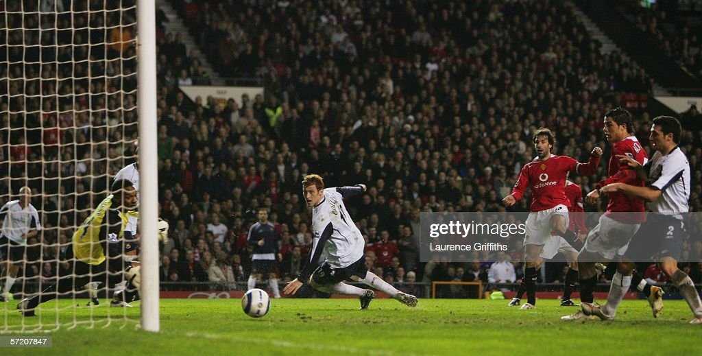 Ruud van Nistelrooy of Manchester United scores the opening goal past Shaka Hislop of West Ham during the Barclays Premiership match between Manchester United and West Ham United at Old Trafford on March 29, 2006 in Manchester, England.