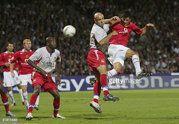 Ruud van Nistelrooy of Manchester United scores the third goal during the UEFA Champions League match between Lyon and Manchester United at the Stade...