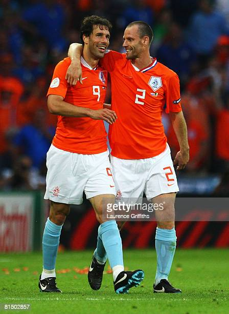 Ruud van Nistelrooy of Netherlands celebrates the opening goal with Andre Ooijer of Netherlands during the Euro 2008 Group C match between...