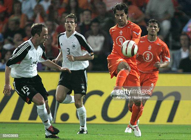 Ruud van Nistelrooy of Netherlands in action with Fabian Ernst of Germany during the international friendly match between Netherlands and Germany at...