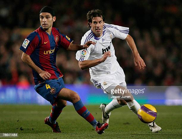 Ruud van Nistelrooy of Real Madrid duels for the ball with Rafael Marquez of Barcelona during the La Liga match between Barcelona and Real Madrid at...