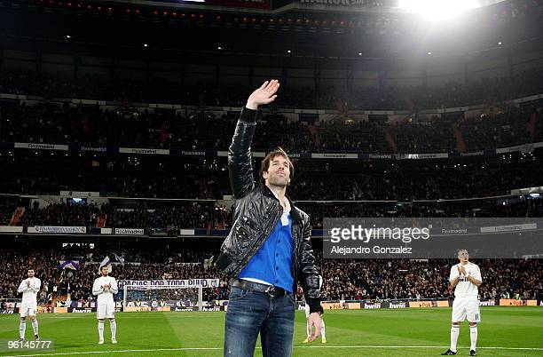Ruud Van Nistelrooy of Real Madrid waves to supporters at the Santiago Bernabeu stadium before the la Liga match between Real Madrid and Malaga at...
