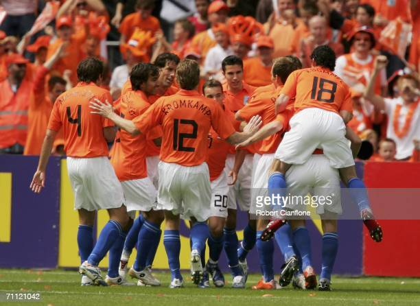 Ruud van Nistelrooy of the Netherlands celebrates with teammtes after scoring a goal during the international friendly match between Netherlands and...