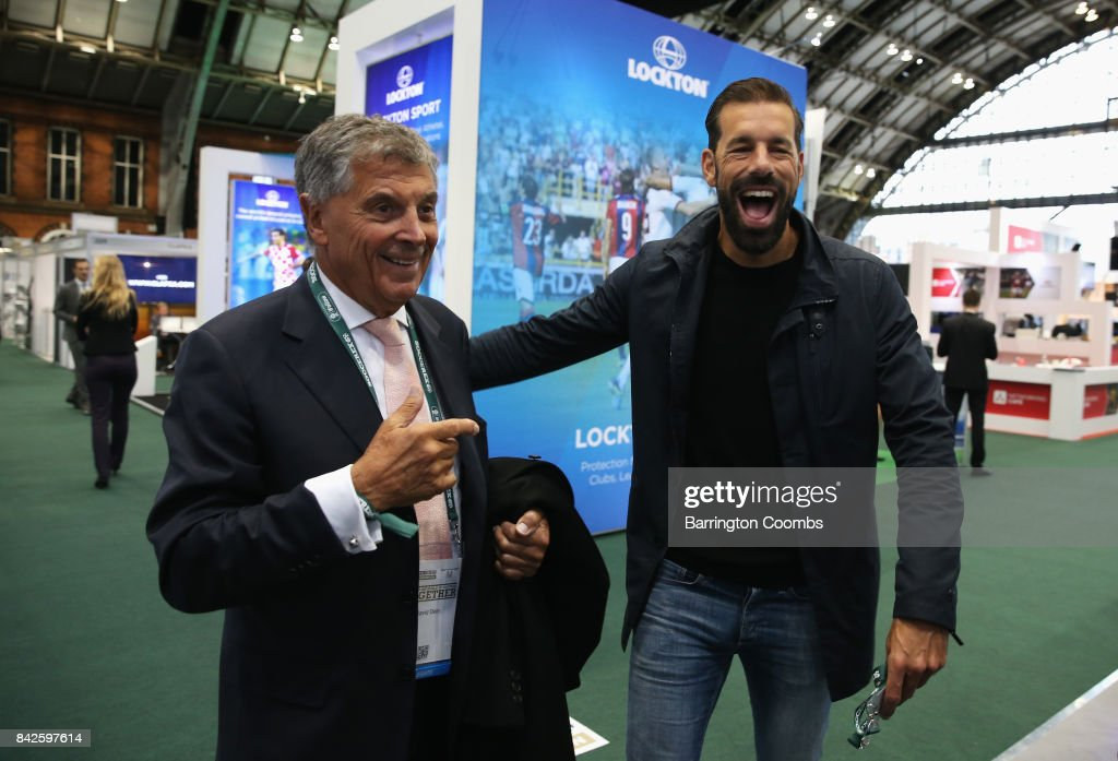 Ruud van Nistelrooy (R) of the Netherlands laughs with David Dein, The FA former Vice-Chairman during day 1 of the Soccerex Global Convention at Manchester Central Convention Complex on September 4, 2017 in Manchester, England.