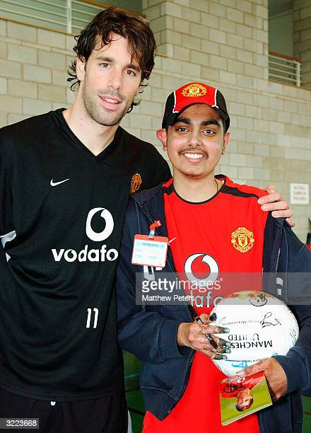 Ruud van Nistelrooy poses with Vishal Ladwa from Peterborough during a Meet and Greet with disabled and terminally ill children at Carrington...