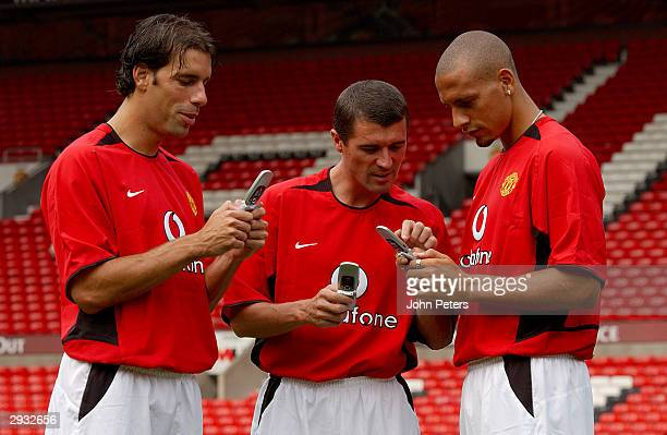 Ruud van Nistelrooy Roy Keane and Rio Ferdinand during the Manchester United official photocall at Old Trafford on August 11 2003 in Manchester...