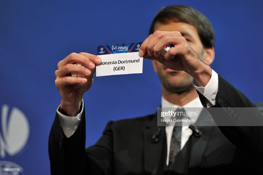 Ruud van Nistelrooy shows the name Borussia Dortmund during the UEFA Champions League semi-final draw at the UEFA headquarters on April 12, 2013 in Nyon, Switzerland.