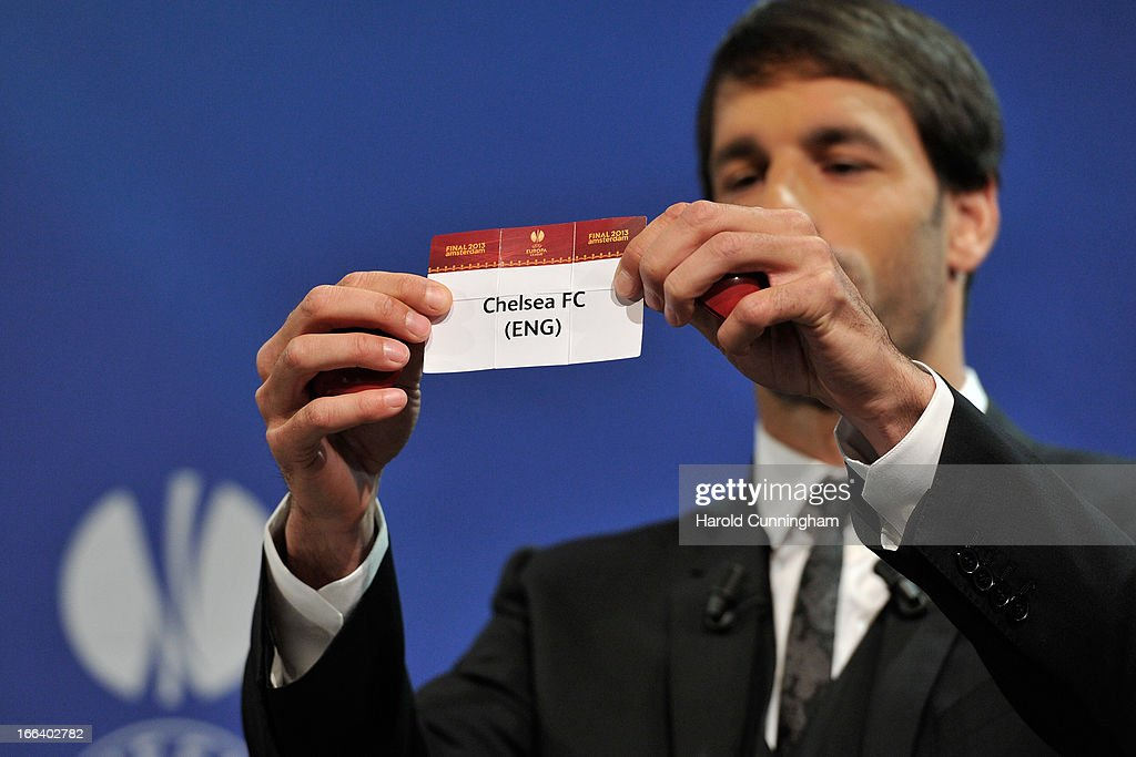 Ruud van Nistelrooy shows the name Chelsea FC during the UEFA Europa League semi-final draw at the UEFA headquarters on April 12, 2013 in Nyon, Switzerland.
