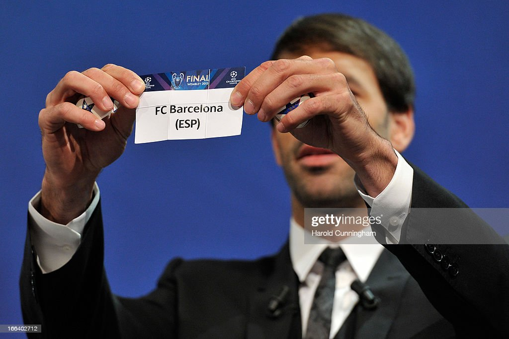 Ruud van Nistelrooy shows the name FC Barcelona during the UEFA Champions League semi-final draw at the UEFA headquarters on April 12, 2013 in Nyon, Switzerland.