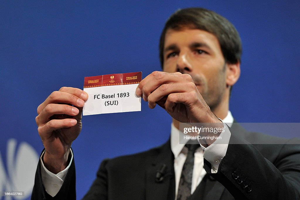 Ruud van Nistelrooy shows the name FC Basel 1893 during the UEFA Europa League semi-final draw at the UEFA headquarters on April 12, 2013 in Nyon, Switzerland.