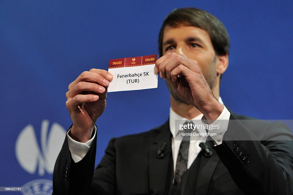 Ruud van Nistelrooy shows the name Fenerbahce SK during the UEFA Europa League semi-final draw at the UEFA headquarters on April 12, 2013 in Nyon, Switzerland.