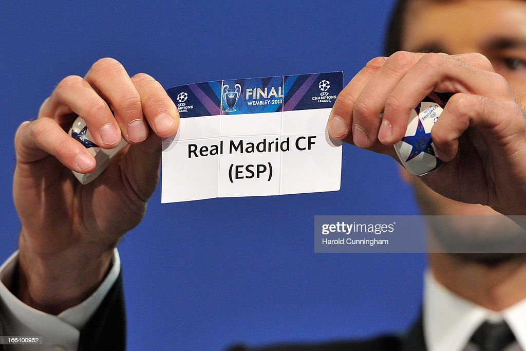 Ruud van Nistelrooy shows the name Real Madrid CF during the UEFA Champions League semi-final draw at the UEFA headquarters on April 12, 2013 in Nyon, Switzerland.