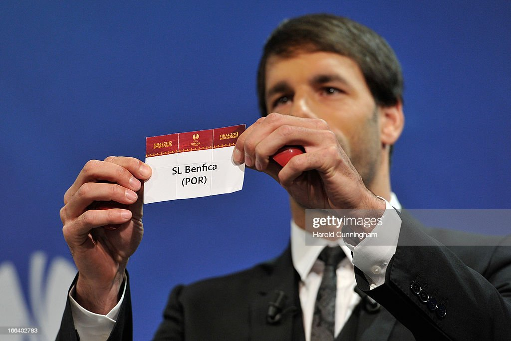 Ruud van Nistelrooy shows the name SL Benfica during the UEFA Europa League semi-final draw at the UEFA headquarters on April 12, 2013 in Nyon, Switzerland.
