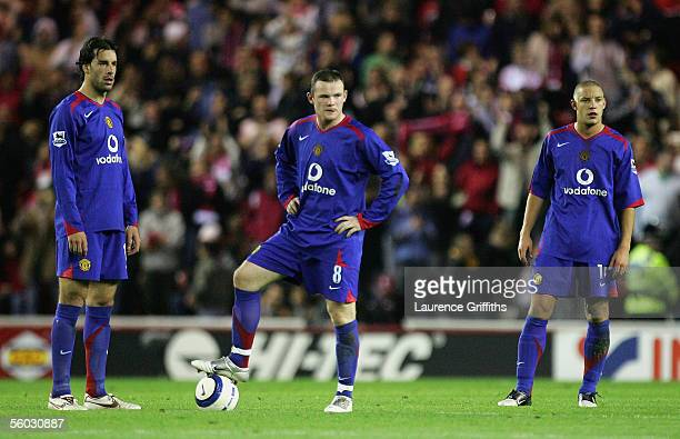 Ruud Van Nistelrooy Wayne Rooney and Alan Smith of Manchester United cant hide their dissapointment as they concede three goals in the first half...