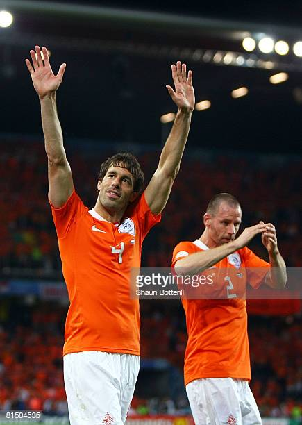 Ruud van Nistelroy and Andre Ooijer of Netherlands celebrate victory after the Euro 2008 Group C match between Netherlands and Italy at Stade de...