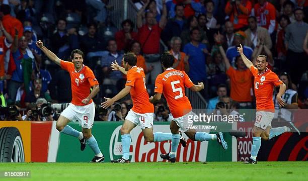 Ruud van Nistelroy of Netherlands celebrates with his team mates Joris Mathijsen Giovanni van Bronckhorst and Wesley Sneijder after scoring the...