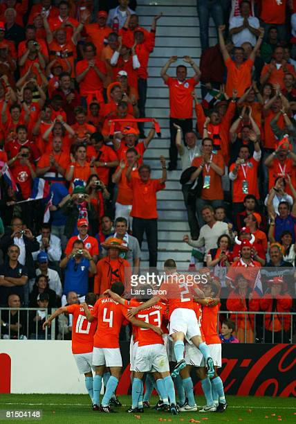 Ruud van Nistelroy of Netherlands celebrates with his team mates after scoring the opening goal during the Euro 2008 Group C match between...
