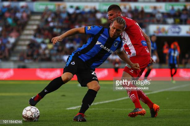 Ruud Vormer of Club Brugge KV battles for the ball with Dimitri Mohamed of Royal Excel Mouscron during the Jupiler Pro League match between Royal...