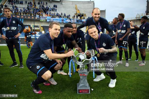 Ruud Vormer, Stefano Denswil, Tahith Chong, Bas Dost and Noa Lang of Club Brugge celebrate the title of champion after the Jupiler Pro League...