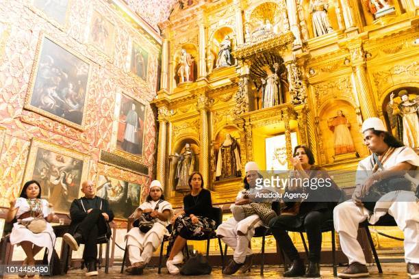 Ruven Afanador and Ana Gonzáles attend a workshop on 'Las hijas del agua' exhibition that shows the culture of Colombian tribes are seen in Bogota...