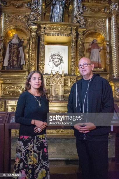 Ruven Afanador and Ana Gonzáles pose after a workshop on 'Las hijas del agua' exhibition that shows the culture of Colombian tribes are seen in...