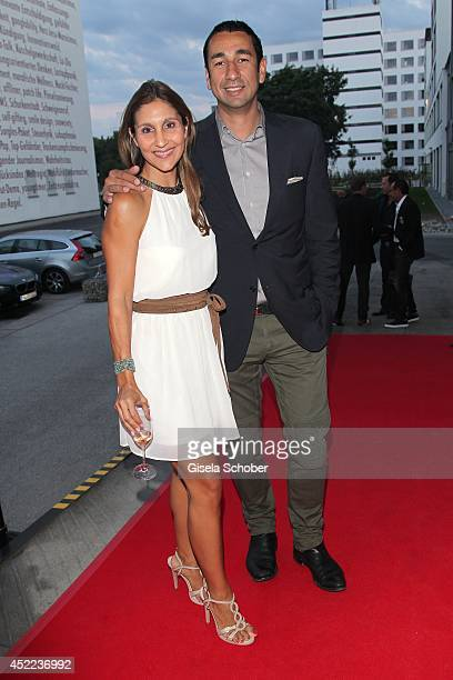 Ruxandra Nitschke and Kosta Kokmotos attend the Norbert Dobeleit 50th birthday party at Stromberg Kutchiin on July 16 2014 in Munich Germany