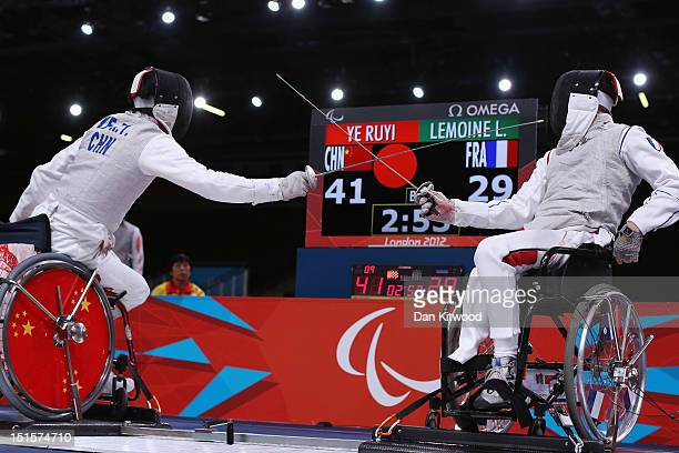 Ruyi Ye of China competes against Ludovic Lemoine of France during the Men's Team Catagory Open Wheelchair Fencing Final on day 10 of the London 2012...