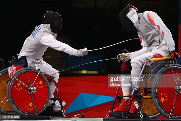 Ruyi Ye of China on his way to winning gold against Yijun Chen of China during the Men's Individual Foil Category A final of the Wheelchair Fencing...