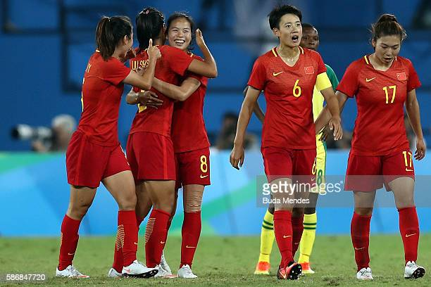 Ruyin Tan of China celebrates with teammates after scoring China's second goal during the Women's Group E first round match between South Africa and...