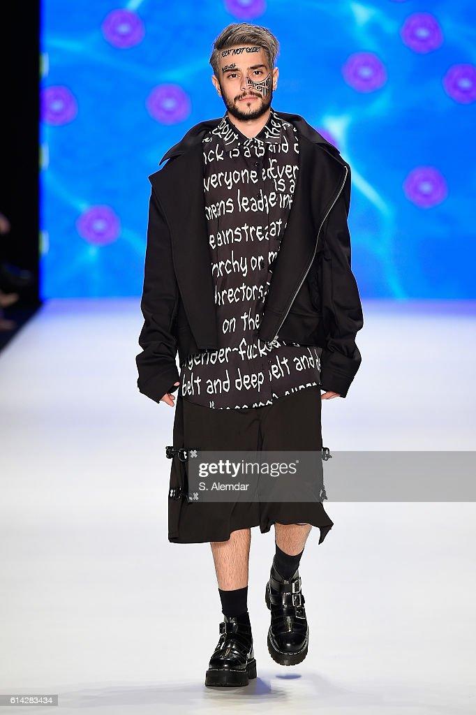 Ruzgar Erkoclar walks the runway at the DB Berdan show during Mercedes-Benz Fashion Week Istanbul at Zorlu Center on October 13, 2016 in Istanbul, Turkey.