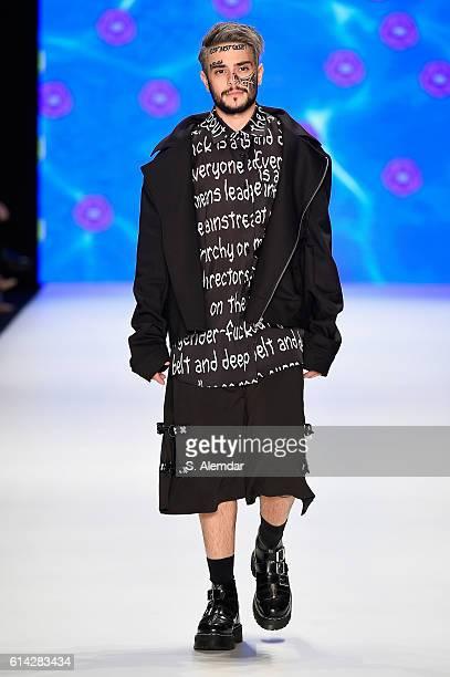 Ruzgar Erkoclar walks the runway at the DB Berdan show during MercedesBenz Fashion Week Istanbul at Zorlu Center on October 13 2016 in Istanbul Turkey