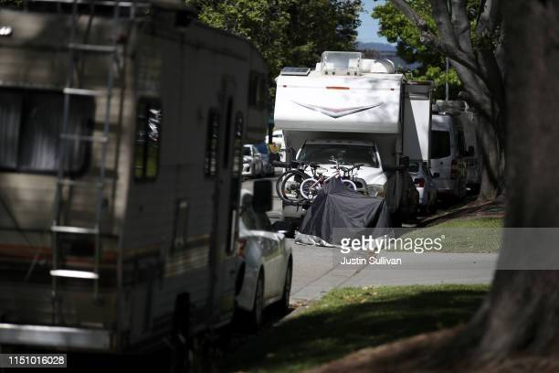 RVs sit parked on a street across from Google headquarters on May 22 2019 in Mountain View California As the price of rent continues to skyrocket in...