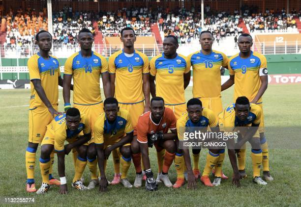 Rwanda national football team's players pose on March 23 2019 at the Felix HouphouetBoigny stadium in Abidjan during the 2019 African Cup of Nations...