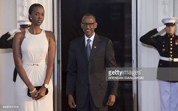Rwanda President Paul Kagame and daughter arrive at the White House for a group dinner during the US Africa Leaders Summit August 5 2014 in...