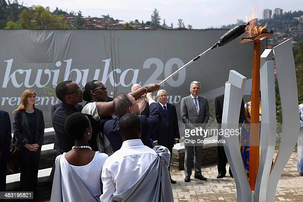 Rwanda President Paul Kagame, first lady Jeannette Kagame and UN Secretary General Ban Ki Moon light the Flame of Remembrance at the Kigali Genocide...