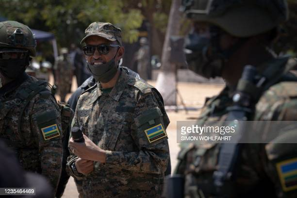 Rwanda President Paul Kagame, wearing military fatigue, smiles on 24 september 2021 in Pemba, Cabo Delgado province, Mozambique, during a visit to...