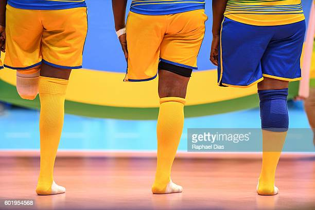 Rwanda sitting volleyball players align for the national anthem before their match against China during the Paralympic Games in Rio de Janeiro...
