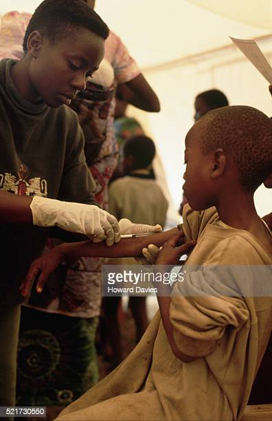 rwandan child receiving measles vaccination, zaire - morbillivirus stock pictures, royalty-free photos & images