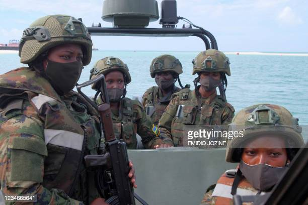 Rwandan female soldiers patrol on a boat in the port city of Mocimboa da Praia, northern Mozambique, on August 13, 2021. - Except for dozens of...