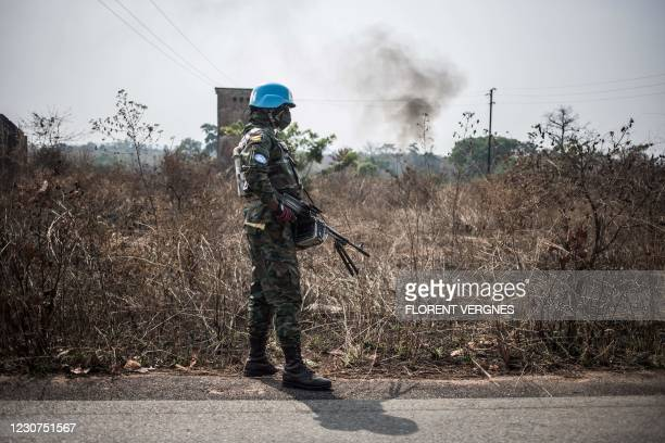 Rwandan machine gun peacekeeper from the United Nations Multidimensional Integrated Stabilization Mission in the Central African Republic stands in...