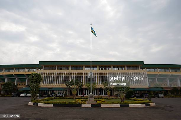 A Rwandan national flag flies outside the Amahoro stadium in Kigali Rwanda on Wednesday Sept 18 2013 Coffeeproducing Rwanda's economy has doubled in...