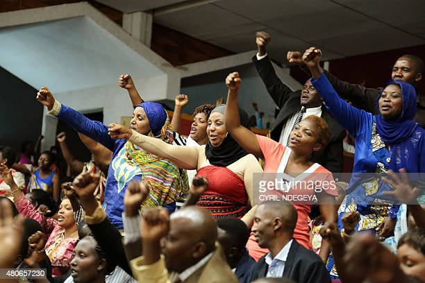 Rwandan people react during the Constitution amendment debate at the parliament in Kigali on July 14 2015 Rwandan lawmakers voted today in support of...